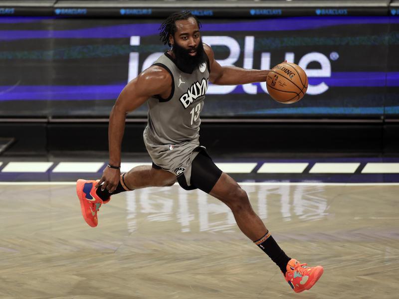 Brooklyn Nets guard James Harden drives to basket