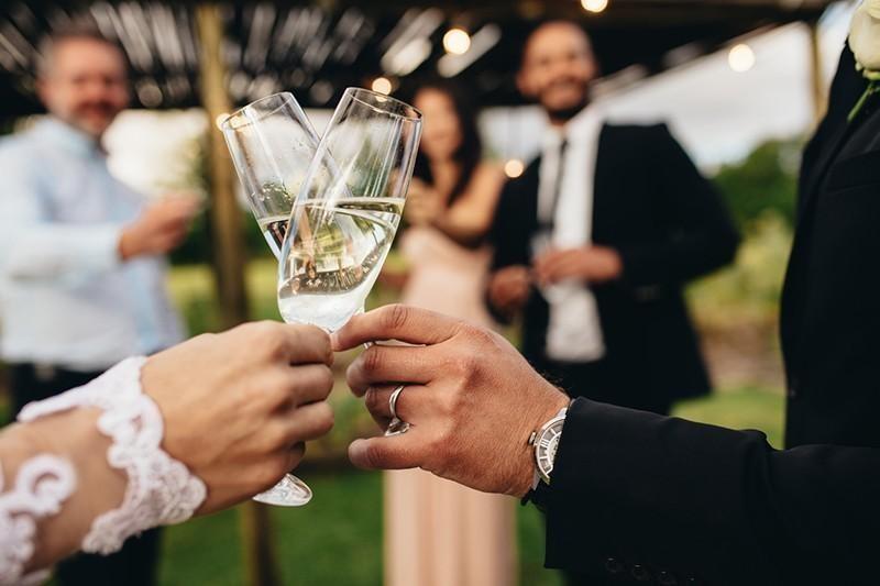 newlyweds toasting