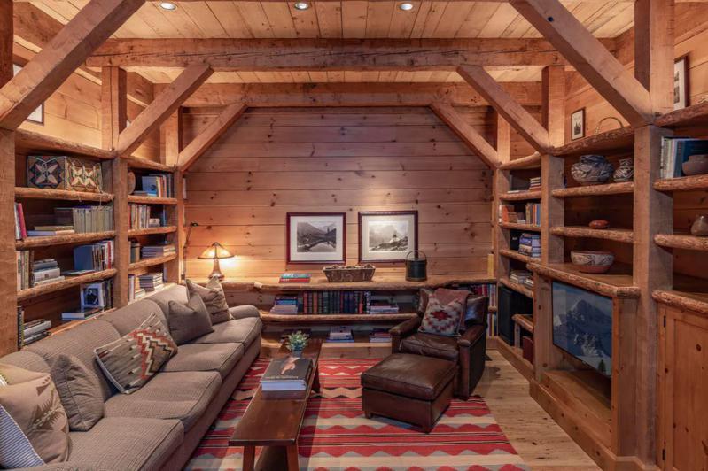 Rustic library with cedar wood shelfs