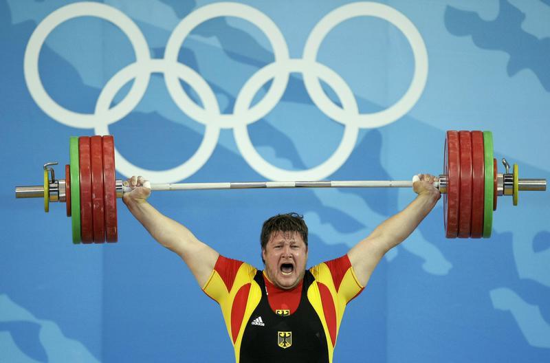 Matthias Steiner of Germany lifts