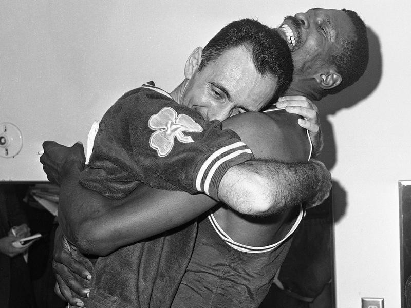Bill Russell hoists teammate Bob Cousy in a victory hug