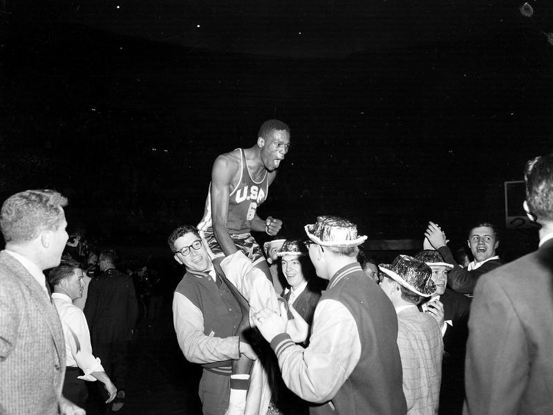 Bill Russell is carried from floor of Kansas City's Auditorium