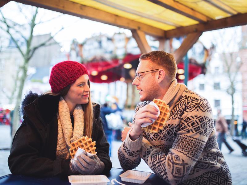 People eating waffles in Belgium