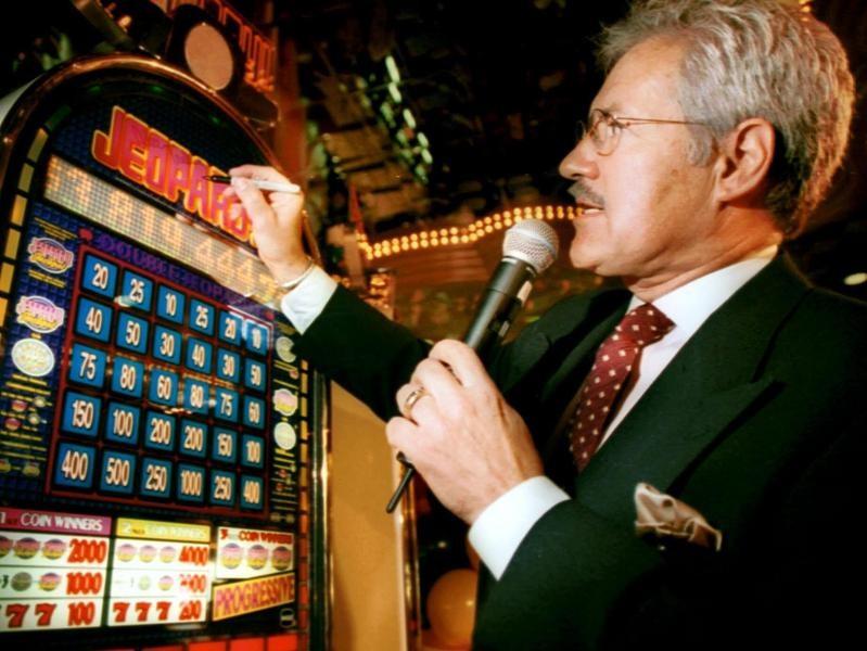 Alex Trebek signing a slot machine in 1999
