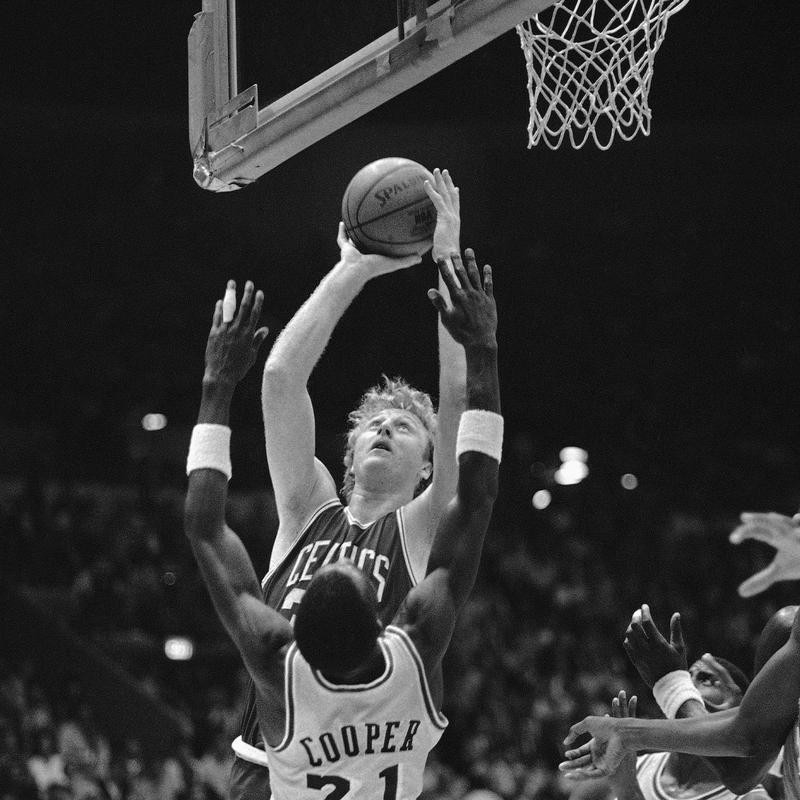 Larry Bird drives to basket