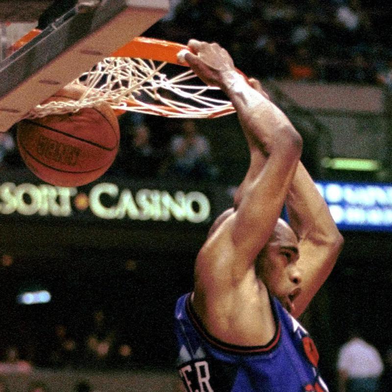 Vince Carter slam dunks ball