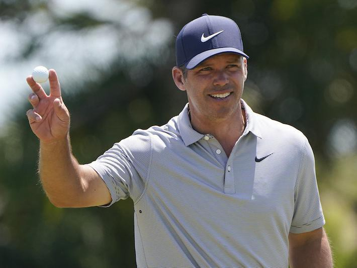 Paul Casey waves on second hole