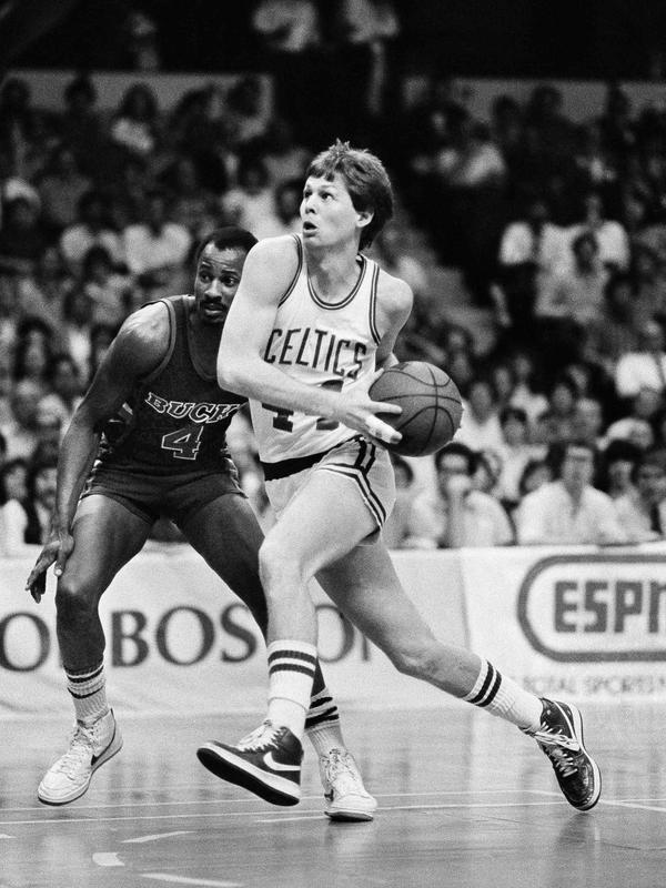 Danny Ainge drives to basket