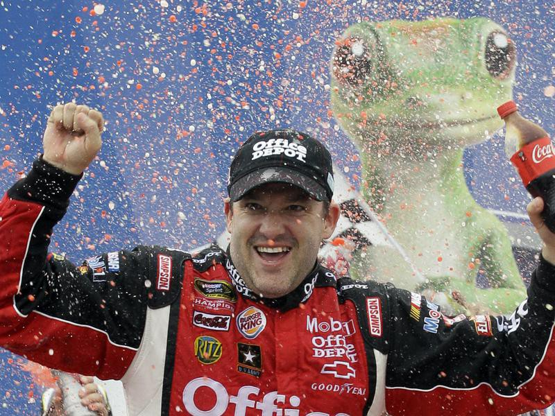 Tony Stewart celebrating after the NASCAR Sprint Cup Series Geico 400 in 2011