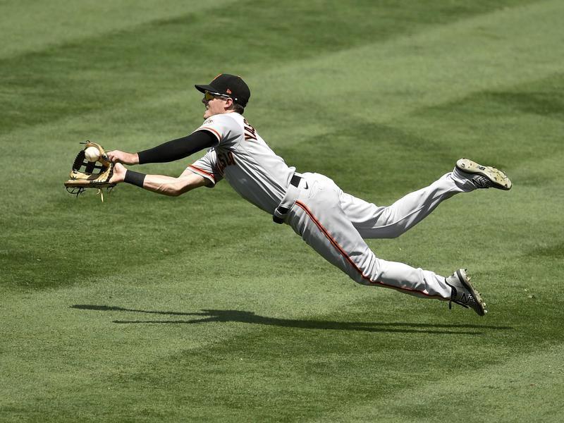 Mike Yastrzemski dives to catch a ball