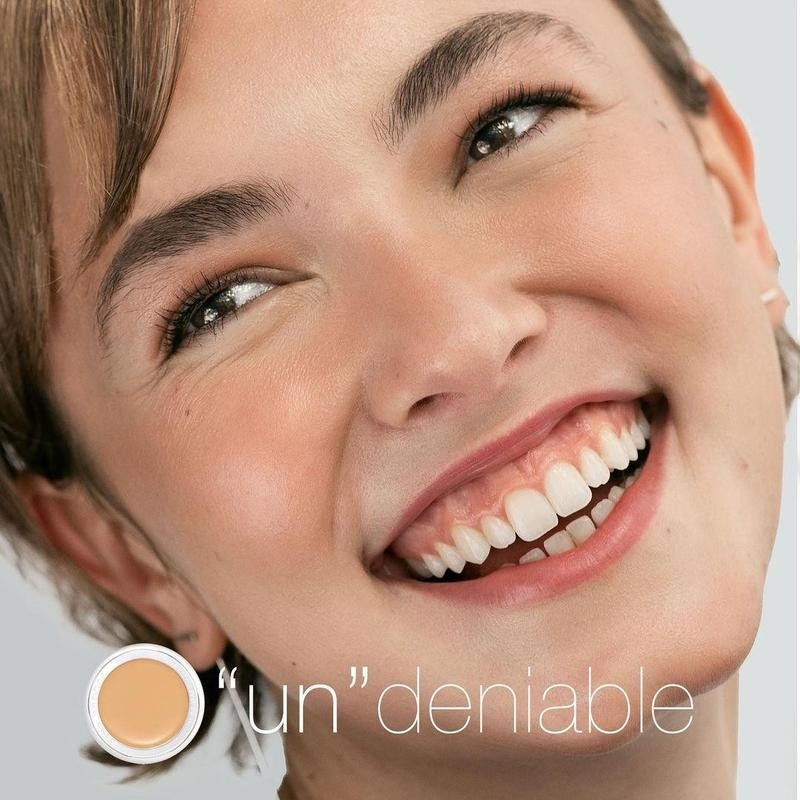 Woman smiling with product alongside
