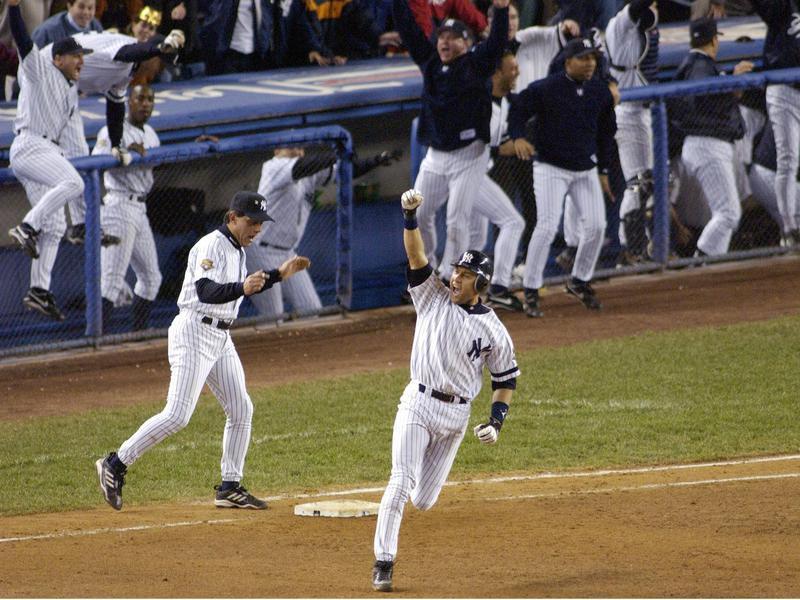 New York Yankees' Derek Jeter celebrates his game-winning home run