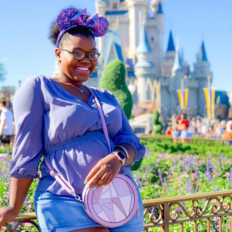 Girl with backpack in Disney