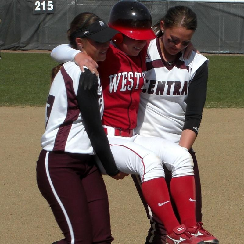 Mallory Holtman and Liz Wallace of Central Washington carry Sara Tucholsky of Western Oregon around the bases