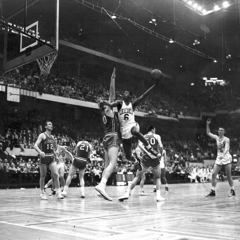 Bill Russell goes up against defense
