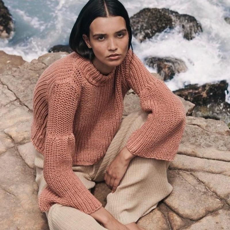 Woman posing in flare sweater