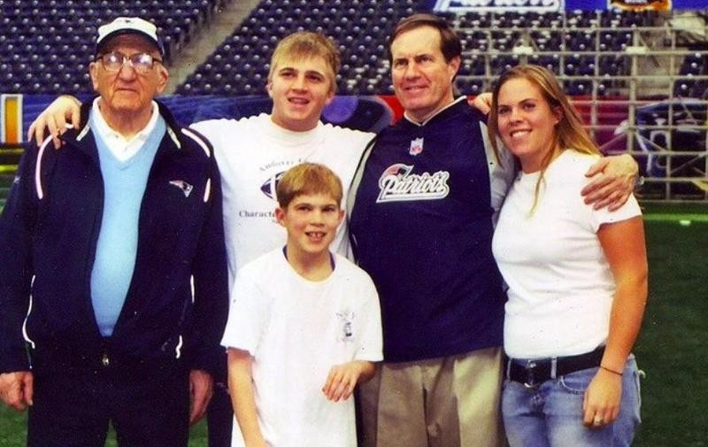 Bill Belichick of the New England Patriots poses with father Steve and family at the field