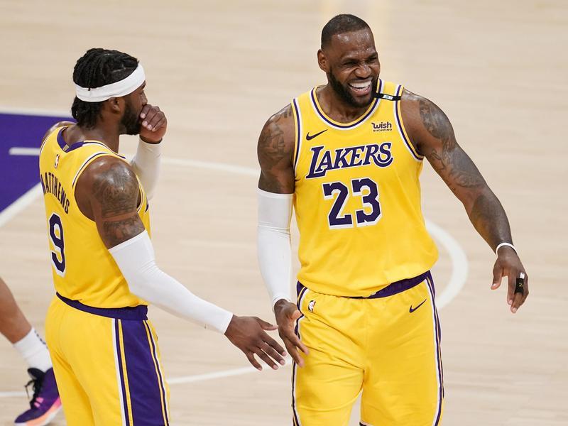 LeBron James smiles with Lakers guard Wesley Matthews
