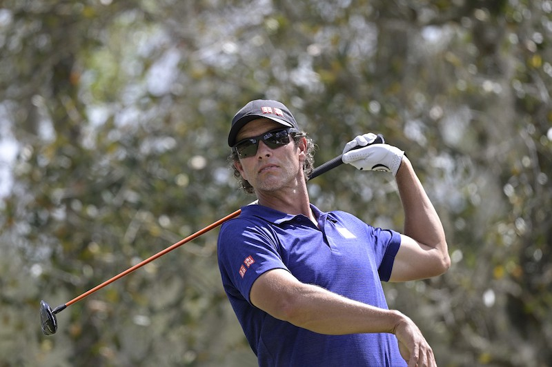 Adam Scott watches after hitting tee shot