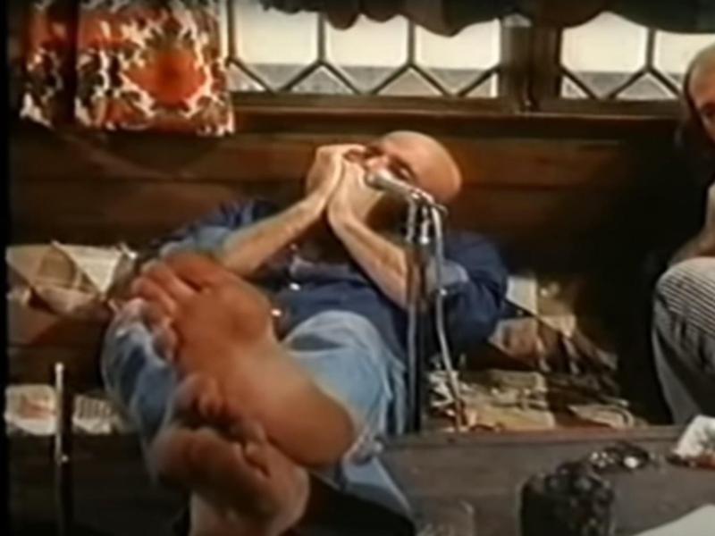 Shel Silverstein with a harmonica