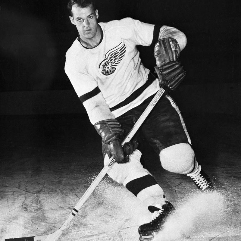 Gordie Howe for Detroit Red Wings posed with puck
