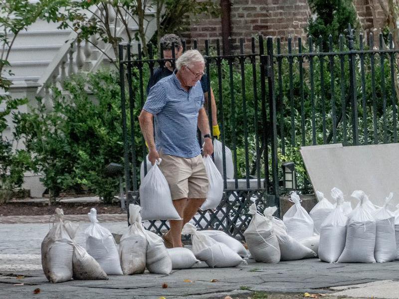 man preparing for hurricane