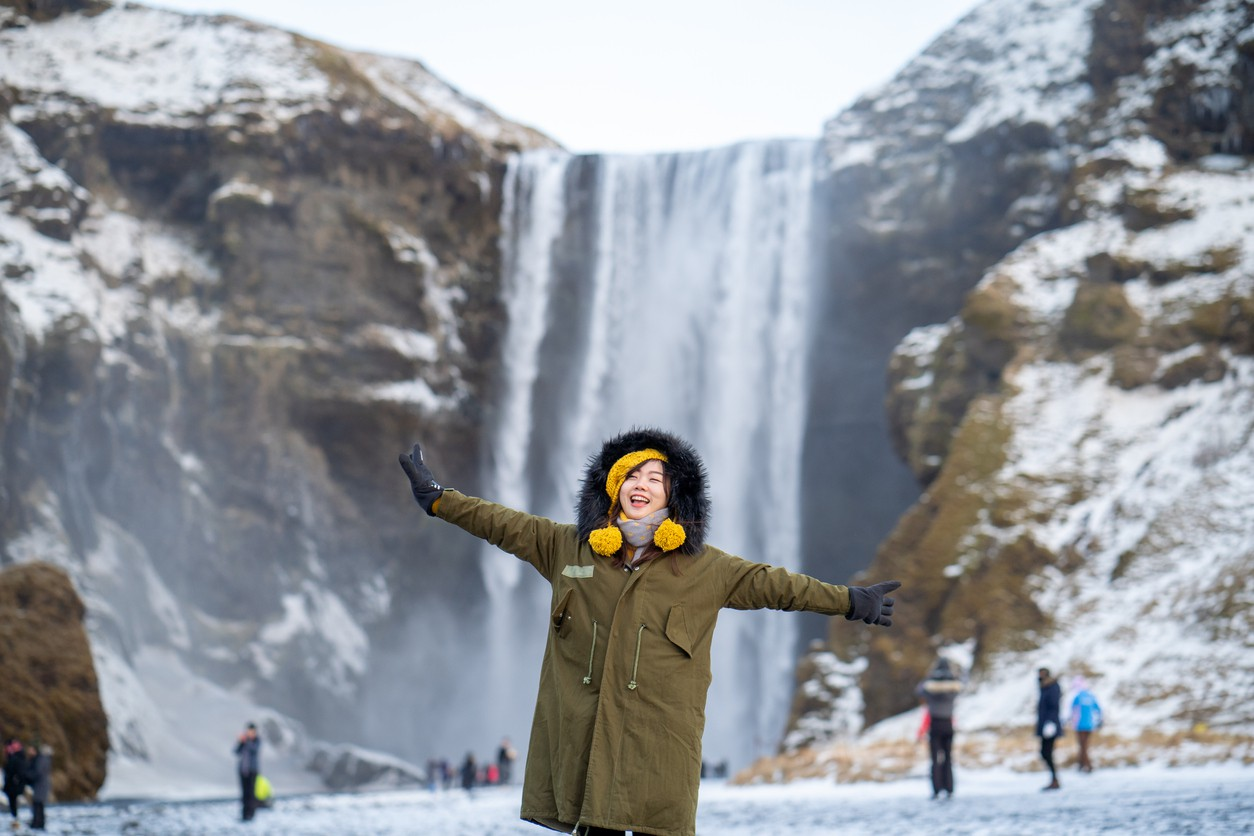 Woman in front of waterfall in iceland