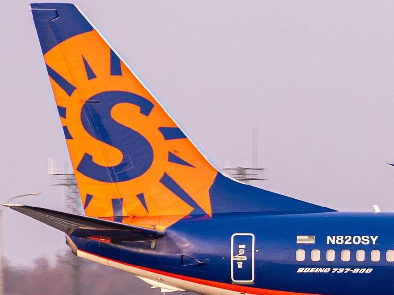 Closeup of Sun Country Airlines logo