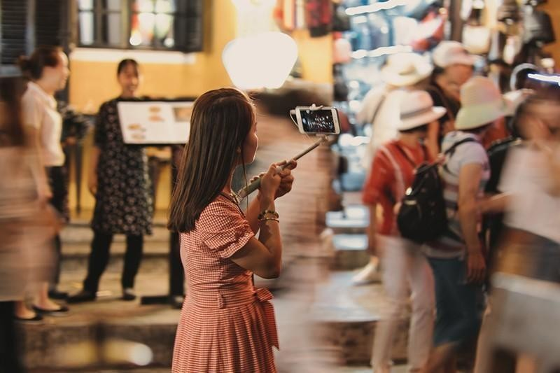 woman taking phone pictures