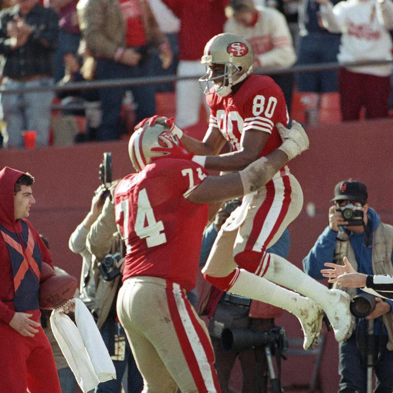 San Francisco 49ers wide receiver Jerry Rice celebrates with teammate Steve Wallace