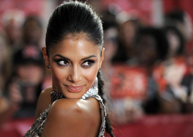 """Nicole Scherzinger, a judge on """"The X Factor,"""" poses at screening event for the television series in 2011. Scherzinger's breakthrough came on """"Popstars."""""""