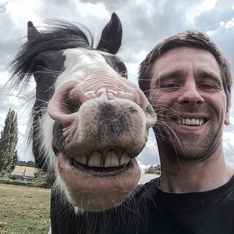 Man Taking Selfie With Horse