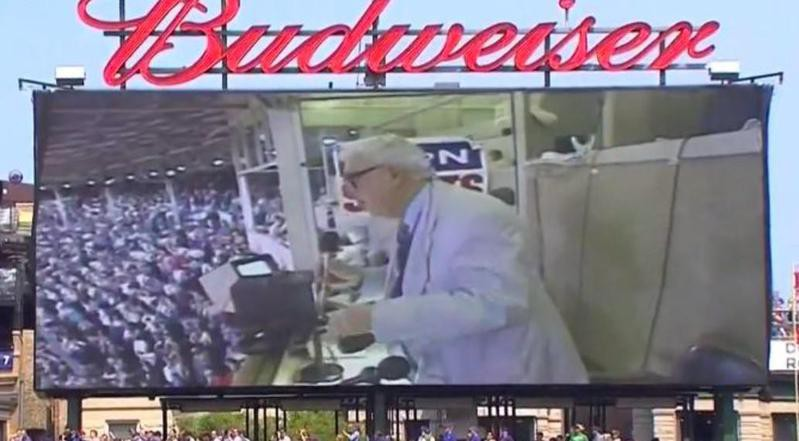 Harry Caray sings the seventh-inning stretch