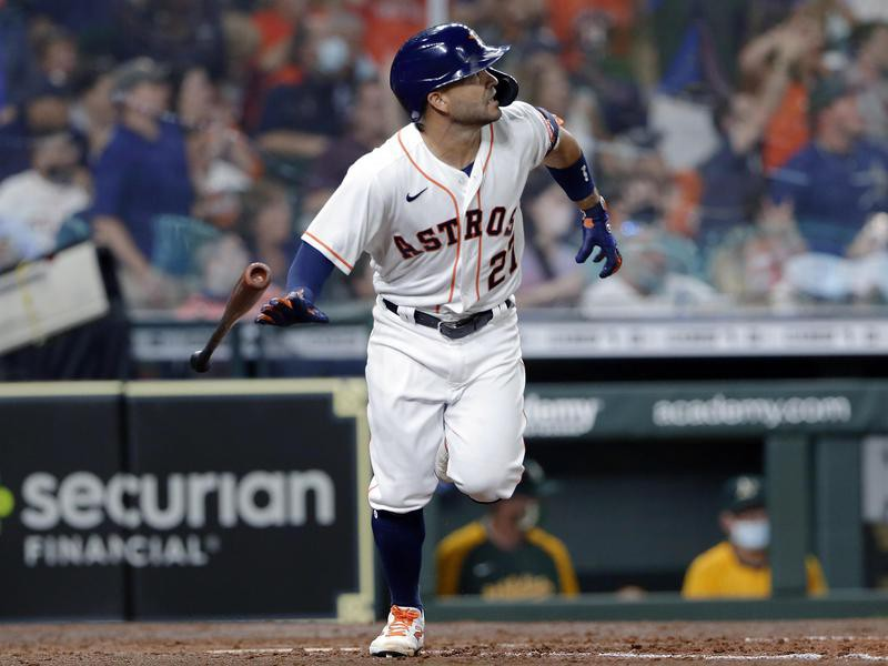 Houston Astros' Jose Altuve flips his bat