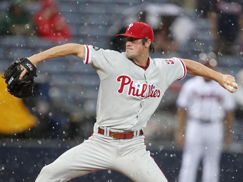 Philadelphia Phillies starter Cole Hamels works in rain