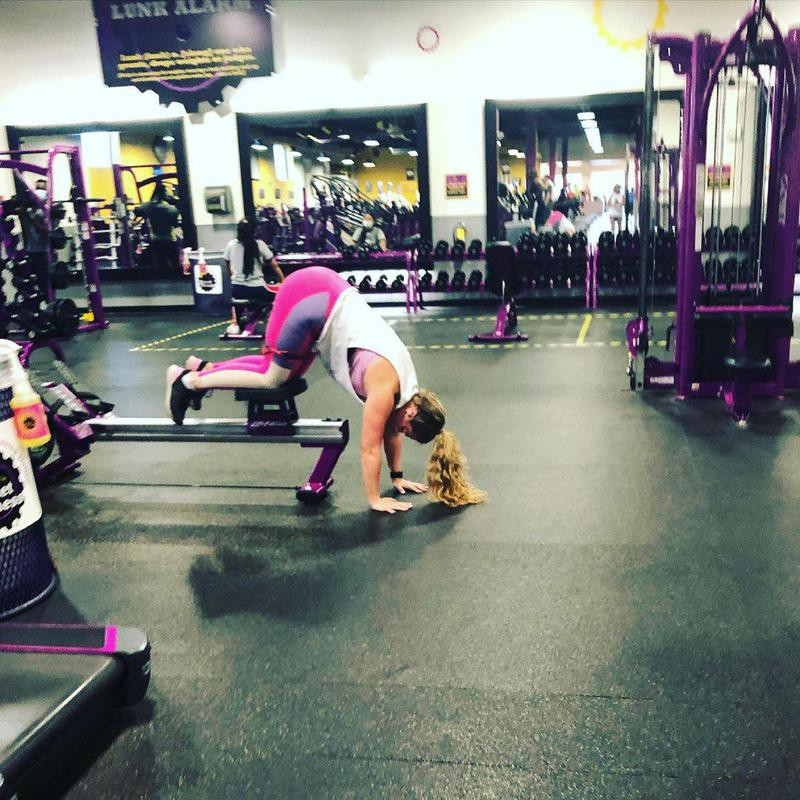 Woman using machine at gym incorrrectly