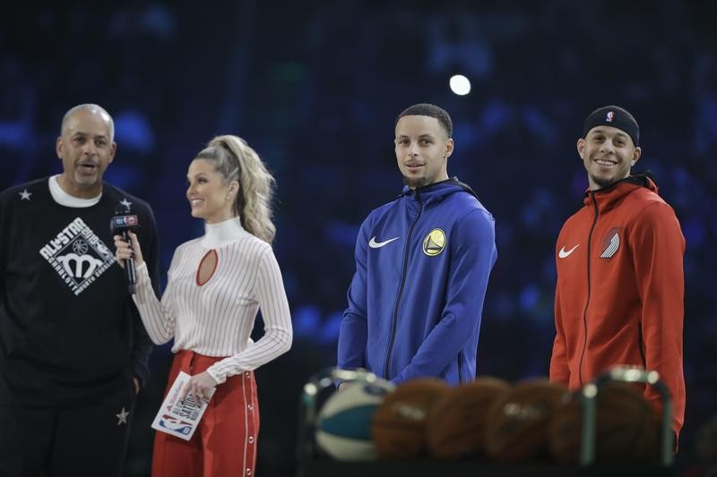 Delly Curry interviewed with his son's Steph Curry and Seth Curry at NBA All Star 3 Point contest