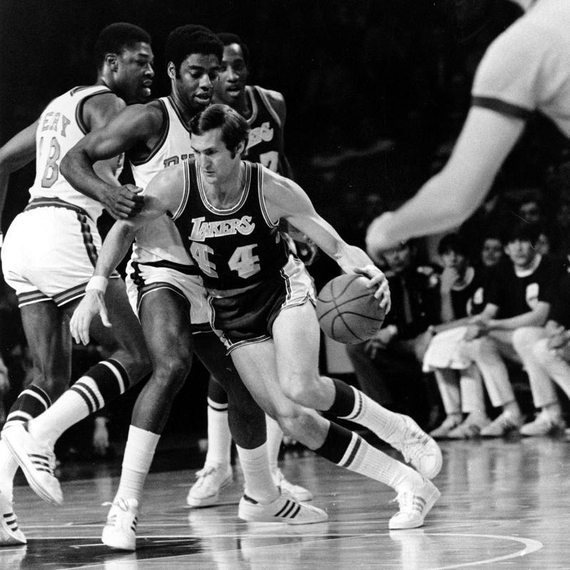 Los Angeles Lakers' Jerry West drives around Milwaukee Bucks' Oscar Robertson