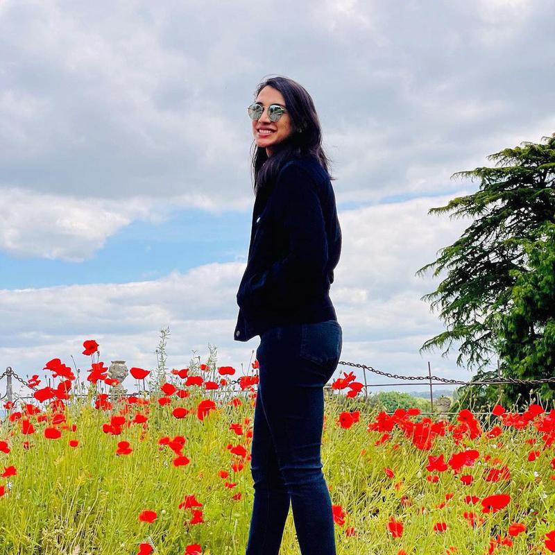 Smriti Mandhana in a field of poppies