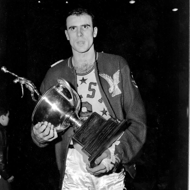Bob Pettit holds up MVP trophy