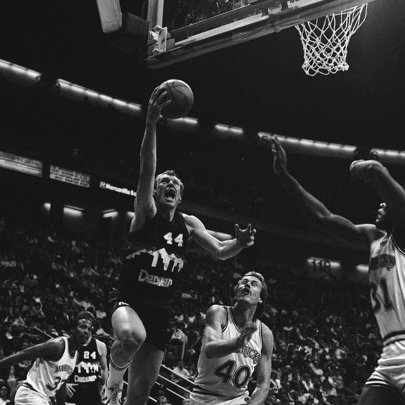 Dan Issel goes up for basket