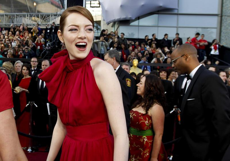 Emma Stone arrives at the Academy Awards in Hollywood, California, in 2012.