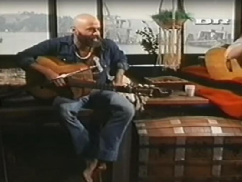 Shel Silverstein playing guitar