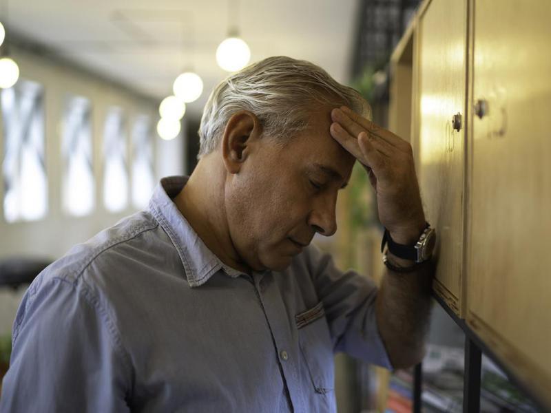 Frustrated senior businessman at work