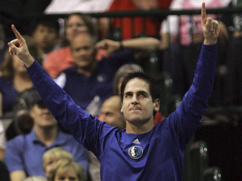 Cuban, shown here celebrating for the Dallas Mavericks, cheered in a much different way when he became a billionaire.