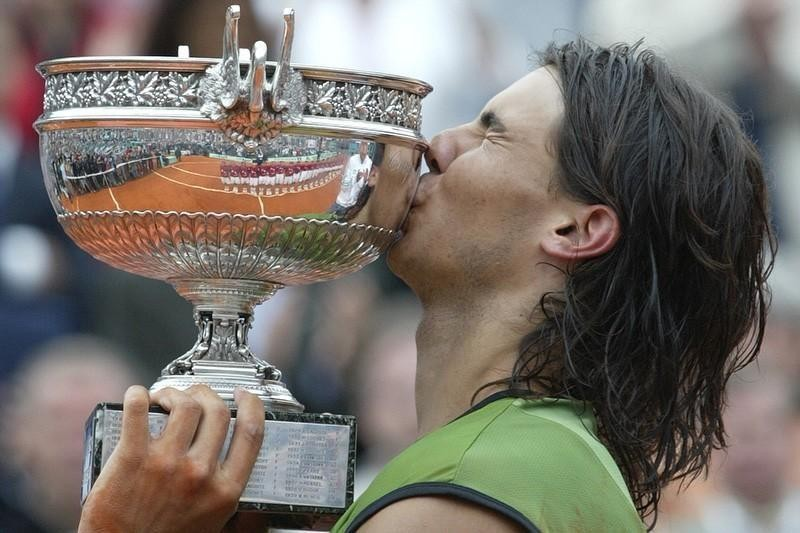 Rafael Nadal kisses the French Open trophy