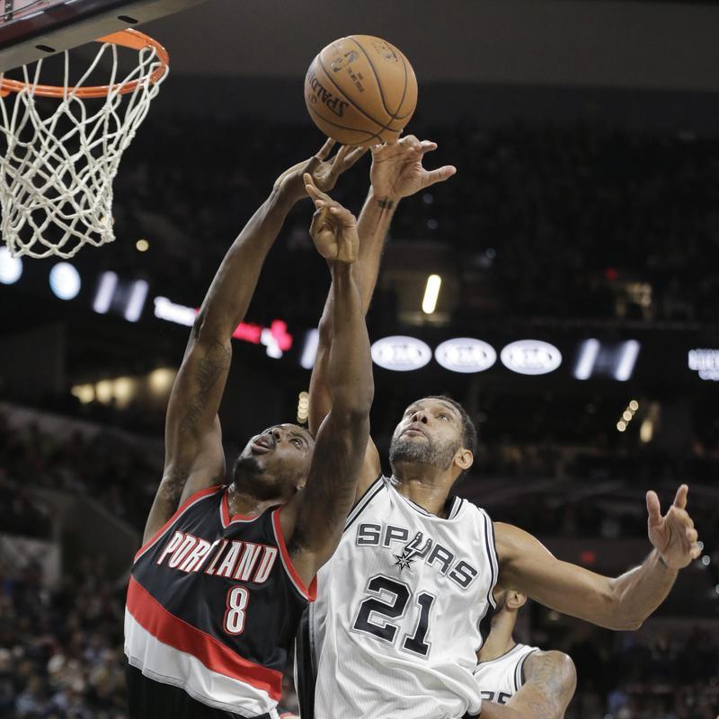 Portland Trail Blazers' Al-Farouq Aminu blocked by San Antonio Spurs' Tim Duncan