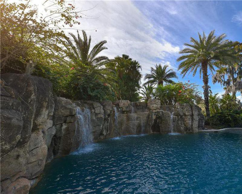 Resort-style water features by Shaq's pool