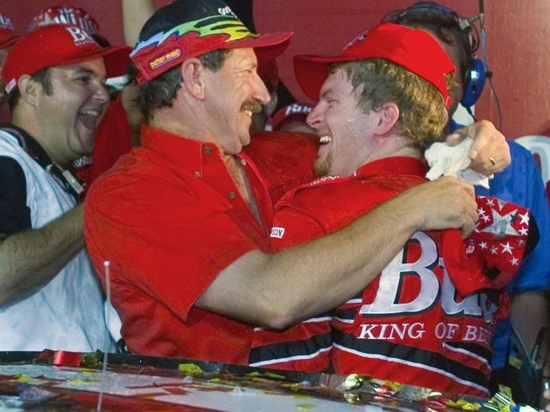 Dale Earnhardt embraces Dale Earnhardt Jr. after winning Winston All-Star Race