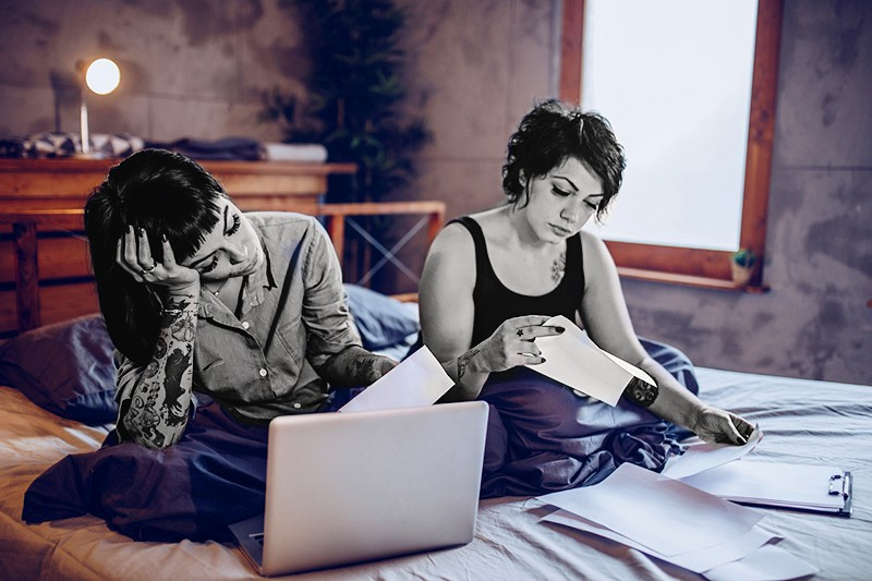 Couple calculating expenses